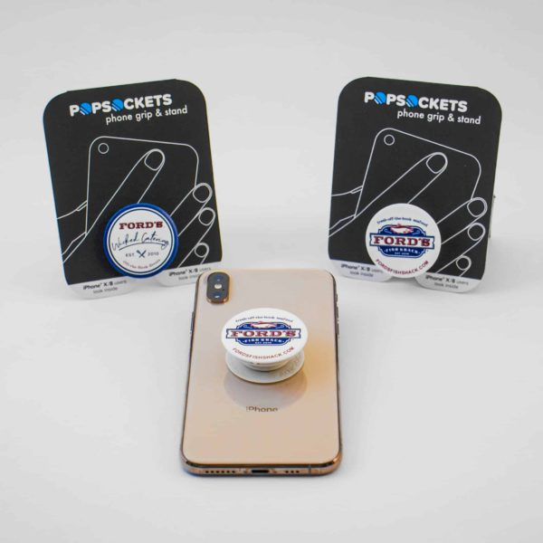 Two Popsockets with Pacakging and One Displayed on Phone
